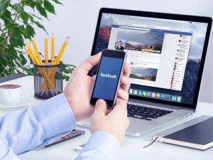 Facebook app on the Apple iPhone display and desktop version of